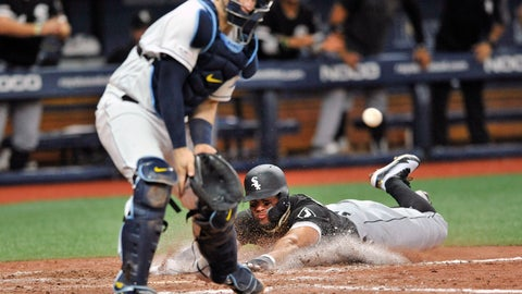 <p>               Chicago White Sox's Yoan Moncada, right, scores the game-winning run ahead of the throw to Tampa Bay Rays catcher Mike Zunino during the 11th inning of a baseball game Saturday, July 20, 2019, in St. Petersburg, Fla. The White Sox beat the Rays 2-1. (AP Photo/Steve Nesius)             </p>