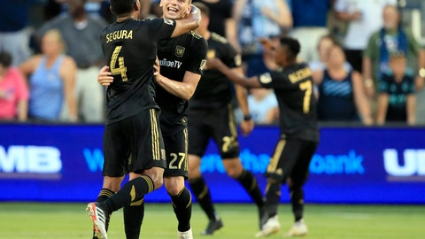 <p>               Los Angeles FC defenders Eddie Segura (4) and Tristan Blackmon (27) celebrate their team's goal during the first half of an MLS soccer match against the Sporting Kansas City in Kansas City, Kan., Wednesday, July 3, 2019. (AP Photo/Orlin Wagner)             </p>