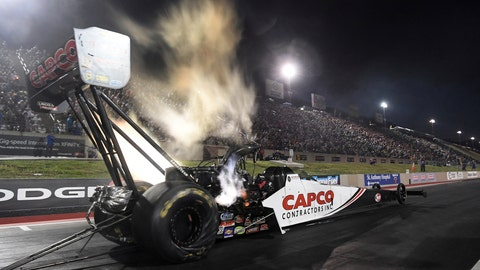 <p>               In this photo provided by the NHRA, Steve Torrence drives in Top Fuel qualifying Friday, July 19, 2019, for the Dodge Mile-High NHRA Nationals drag races at Bandimere Speedway in Morrison, Colo. (Jerry Foss/NHRA via AP)             </p>