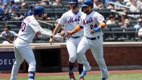 <p>               New York Mets' Michael Conforto, left, reaches out to Robinson Cano, right, and Pete Alonso, center, after they scored on a double by Todd Frazier against the San Diego Padres in the first inning of a baseball game, Thursday, July 25, 2019 in New York. (AP Photo/Mark Lennihan)             </p>