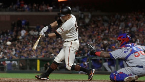 <p>               San Francisco Giants' Joe Panik, left, hits an RBI-double in front of Chicago Cubs catcher Martin Maldonado during the eighth inning of a baseball game in San Francisco, Monday, July 22, 2019. (AP Photo/Jeff Chiu)             </p>
