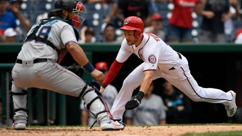 <p>               Washington Nationals' Trea Turner, right, comes home to score on a double by Gerardo Parra against Miami Marlins catcher Jorge Alfaro (38) during the sixth inning of a baseball game, Thursday, July 4, 2019, in Washington. The Nationals won 5-2. (AP Photo/Nick Wass)             </p>
