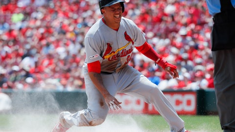 <p>               St. Louis Cardinals' Yairo Munoz slides in to score on a fielding error  in the second inning of a baseball game, Sunday, July 21, 2019, in Cincinnati. (AP Photo/John Minchillo)             </p>