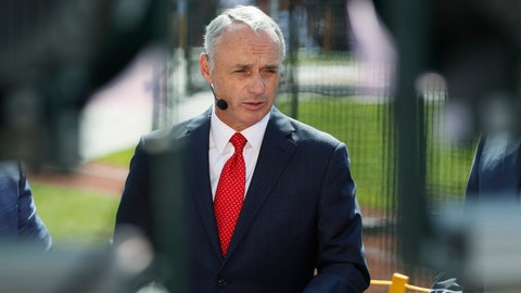 <p>               Commissioner Rob Manfred is interviewed as the American League players warm-up for the MLB baseball All-Star Game, Tuesday, July 9, 2019, in Cleveland. (AP Photo/John Minchillo)             </p>