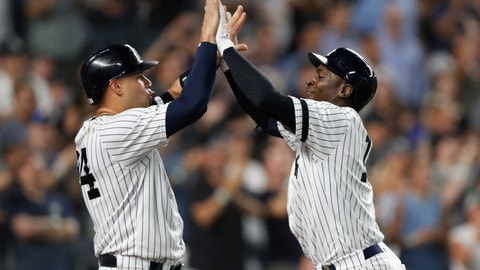 <p>               New York Yankees' Gary Sanchez, left, congratulates Didi Gregorius after scoring on Gregorius' grand slam during the eighth inning of the team's baseball game against the Tampa Bay Rays, Tuesday, July 16, 2019, in New York. (AP Photo/Kathy Willens)             </p>