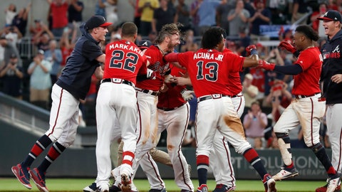 <p>               Atlanta Braves' Josh Donaldson, center, is mobbed by his teammates after driving in the winning run with a base hit in the ninth inning of a baseball game against the Washington Nationals, Friday, July 19, 2019, in Atlanta. (AP Photo/John Bazemore)             </p>