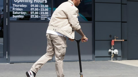 <p>               Mercedes driver Lewis Hamilton of Britain rides a scooter in the paddock of the Silverstone racetrack, in Silverstone, England, Thursday, July 11, 2019. The British Formula One Grand Prix will be held on Sunday. (AP Photo/Luca Bruno)             </p>