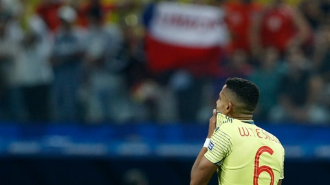 <p>               Colombia's William Tesillo reacts after missing his shot during a penalty kick shoot-out against Chile in a Copa America quarterfinal soccer match at the Arena Corinthians in Sao Paulo, Brazil, Friday, June 28, 2019. Chile beat Colombia 5-4 on penalties after the match ended 0-0. (AP Photo/Victor R. Caivano)             </p>