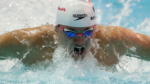 <p>               Singapore's Joseph Schooling swims in his heat of the men's 100m butterfly at the World Swimming Championships in Gwangju, South Korea, Friday, July 26, 2019. (AP Photo/Mark Schiefelbein)             </p>