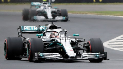 <p>               Mercedes driver Lewis Hamilton of Britain steers his car followed by Mercedes driver Valtteri Bottas of Finland during the third free practice at the Silverstone racetrack, in Silverstone, England, Saturday, July 13, 2019. The British Formula One Grand Prix will be held on Sunday. (AP Photo/Luca Bruno)             </p>