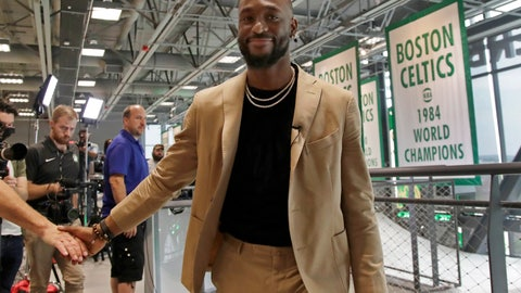 <p>               Newly acquired Boston Celtics guard Kemba Walker shakes a hand as he leaves an interview at the Celtics' basketball practice facility, Wednesday, July 17, 2019, in Boston. (AP Photo/Elise Amendola)             </p>