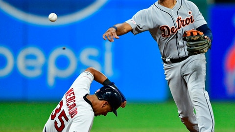 <p>               Detroit Tigers' Jeimer Candelario throws to first base after forcing out Cleveland Indians' Oscar Mercado at second base in the seventh inning of a baseball game, Tuesday, July 16, 2019, in Cleveland. Carlos Santana was out at first base. The Indians won 8-0. (AP Photo/David Dermer)             </p>