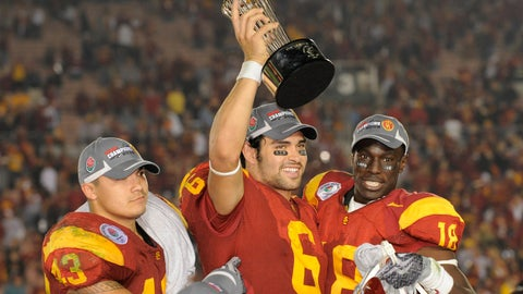 <p>               FILE - In this Jan. 1, 2009, file photo, Southern California quarterback Mark Sanchez (6) holds up the trophy as he celebrates with teammates Kaluka Maiava, left, and Damian Williams (18) after USC beat Penn State 38-24 in the Rose Bowl NCAA college football game, in Pasadena, Calif. Former USC star and New York Jets first-round pick Mark Sanchez is retiring from the NFL and joining ESPN as a college football analyst. (AP Photo/Mark J. Terrill, File)             </p>
