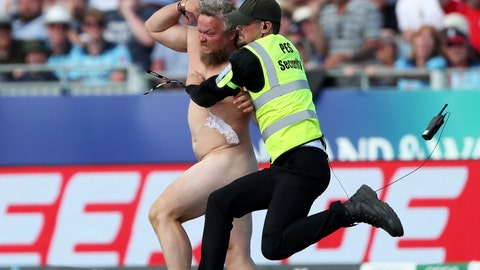 <p>               A security officer jumps to restrain a streaker who ran into the field during the Cricket World Cup match between New Zealand and England in Chester-le-Street, England, Wednesday, July 3, 2019. Security appeared very slow to react as the spectator jogged toward the wicket and danced about in front of New Zealand batsmen Tom Latham and Mitchell Santner. He then weaved around security staff as they attempted to stop him before he was brought to the ground. (AP Photo/Scott Heppell)             </p>