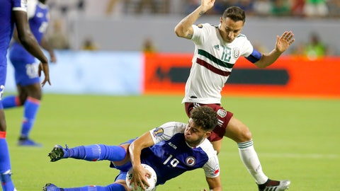 <p>               Haiti midfielder Steeven Saba and Mexico midfielder Andres Guardado (18) fight for the ball during the first half of a CONCACAF Gold Cup soccer match, Tuesday, July 2, 2019, in Glendale, Ariz. (AP Photo/Rick Scuteri)             </p>