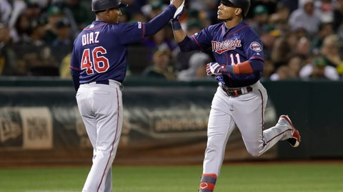 <p>               Minnesota Twins' Jorge Polanco, right, is congratulated by third base coach Tony Diaz (46) after hitting a home run off Oakland Athletics' Joakim Soria in the eighth inning of a baseball game Wednesday, July 3, 2019, in Oakland, Calif. (AP Photo/Ben Margot)             </p>