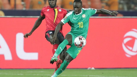 <p>               Uganda's Bevis Kristofer Kizito Mugabi, left, and Senegal's Sadio Mane fight for the ball during the African Cup of Nations round of 16 soccer match between Uganda and Senegal in Cairo International stadium in Cairo, Egypt, Friday, July 5, 2019. (AP Photo/Hassan Ammar)             </p>