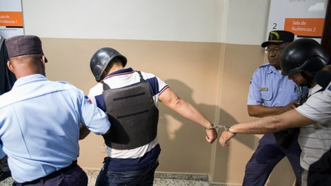 <p>               Police officers escort suspects implicated in the shooting of former Boston Red Sox slugger David Ortiz, Víctor Hugo Gómez Vázquez, left, and Alberto Rodríguez Mota, right, out of the courtroom in Santo Domingo Este, Dominican Republic, Saturday, June 29, 2019. Ortiz was shot in the back at a bar in the Dominican Republic on Sunday, June 9. (AP Photo/Tatiana Fernandez)             </p>