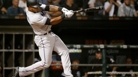 <p>               Miami Marlins' Cesar Puello hits a two-run home run off Chicago White Sox starting pitcher Reynaldo Lopez during the eighth inning of a baseball game Wednesday, July 24, 2019, in Chicago. Harold Ramirez also scored. (AP Photo/Charles Rex Arbogast)             </p>