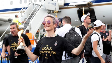 <p>               United States women's soccer team member Megan Rapinoe holds the Women's World Cup trophy after arriving with teammates at Newark Liberty International Airport, Monday, July 8, 2019, in Newark, N.J. (AP Photo/Kathy Willens)             </p>