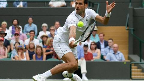 <p>               Serbia's Novak Djokovic returns the ball to Ugo Humbert of France in a men's singles match during day seven of the Wimbledon Tennis Championships in London, Monday, July 8, 2019. (AP Photo/Kirsty Wigglesworth)             </p>