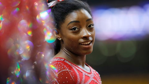 <p>               FILE - In this Nov. 2, 2018, file photo, Simone Biles talks to other gymnasts as she warms up on the second and last day of the apparatus finals of the Gymnastics World Championships at the Aspire Dome in Doha, Qatar. With the Olympics a year away, the world's best gymnast believes there's always a new wrinkle, twist or turn to be added to her routine to stay ahead of her competitors. Biles will face some of American challengers in this weekend's GK US Classic, a prelude to next month's Nationals.  (AP Photo/Vadim Ghirda, FIle)             </p>