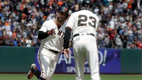 <p>               San Francisco Giants' Evan Longoria, left, is congratulated by third base coach Ron Wotus (23) after hitting a solo home run against the St. Louis Cardinals during the seventh inning of a baseball game in San Francisco, Sunday, July 7, 2019. (AP Photo/Jeff Chiu)             </p>
