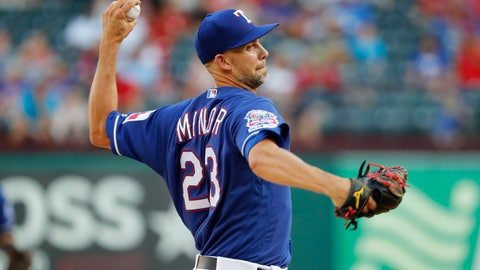 <p>               Texas Rangers' Mike Minor throws to a Seattle Mariners batter during the first inning of a baseball game in Arlington, Texas, Wednesday, July 31, 2019. (AP Photo/Tony Gutierrez)             </p>