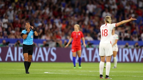 LYON, FRANCE - JULY 02: Referee Edina Alves Batista signals for a VAR review after Ellen White of England scores a goal during the 2019 FIFA Women's World Cup France Semi Final match between England and USA at Stade de Lyon on July 02, 2019 in Lyon, France. (Photo by Richard Heathcote/Getty Images)