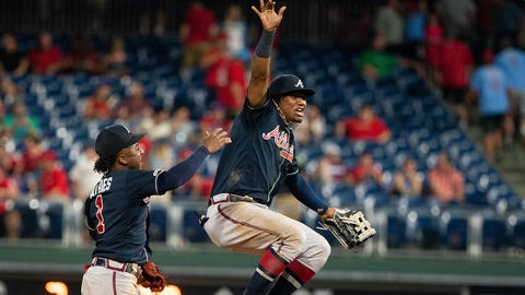 Jul 26, 2019; Philadelphia, PA, USA; Atlanta Braves center fielder Ronald Acuna Jr. (13) and second baseman Ozzie Albies (1) celebrate a victory against the Philadelphia Phillies at Citizens Bank Park. Mandatory Credit: Bill Streicher-USA TODAY Sports