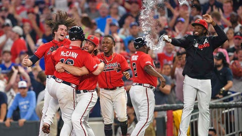 Jul 5, 2019; Atlanta, GA, USA; Atlanta Braves players celebrate with catcher Brian McCann (16) after his game winning hit against the Miami Marlins during the ninth inning at SunTrust Park. Mandatory Credit: Dale Zanine-USA TODAY Sports