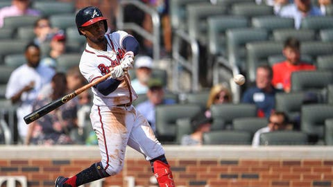 Jul 6, 2019; Atlanta, GA, USA; Atlanta Braves second baseman Ozzie Albies (1) doubles against the Miami Marlins during the third inning at SunTrust Park. Mandatory Credit: Dale Zanine-USA TODAY Sports