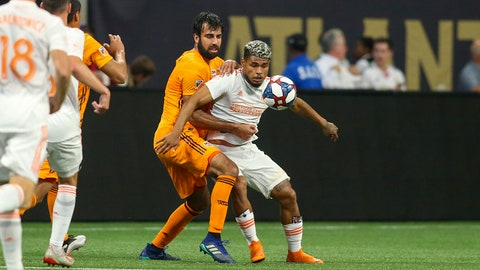 Jul 17, 2019; Atlanta, GA, USA; Atlanta United forward Josef Martinez (7) battles for the ball with Houston Dynamo defender Kevin Garcia (16) in the first half at Mercedes-Benz Stadium. Mandatory Credit: Brett Davis-USA TODAY Sports