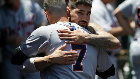 <p>               Detroit Tigers' Nicholas Castellanos, right, hugs farewell to Jordy Mercer in the dugout, after Castellanos is traded to the Chicago Cubs, during the first inning of a baseball game against the Los Angeles Angels in Anaheim, Calif., Wednesday, July 31, 2019. (AP Photo/Alex Gallardo)             </p>