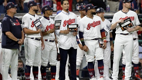 """<p>               FILE - In this July 9, 2019, file photo, Cleveland Indians pitcher Carlos Carrasco, center without a hat, stands with Indians teammates during the fifth inning of the baseball All-Star Game in Cleveland, as part of Major League Baseball's """"Stand Up to Cancer"""" campaign. Carrasco, who was diagnosed with leukemia and was honored during Tuesday's, July 9 All-Star Game, will throw a bullpen session and he's confident he can overcome his condition and pitch again for Cleveland this season.  (AP Photo/Tony Dejak, File)             </p>"""