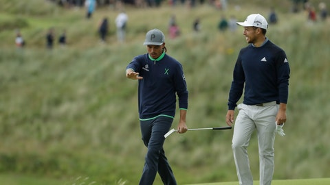 <p>               Rickie Fowler of the United States, left talks to Xander Schauffele of the United States as they walk to the 16th green during the third round of the British Open Golf Championships at Royal Portrush in Northern Ireland, Saturday, July 20, 2019.(AP Photo/Matt Dunham)             </p>