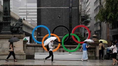 <p>               Commuters walk past the Olympic Rings Tuesday, July 23, 2019, in Tokyo. To mark the year-to-go mark, the gold, silver and bronze Olympic medals are to be unveiled Wednesday as part of daylong ceremonies around the Japanese capital. Tokyo's 1964 Olympics showcased bullet trains, futuristic designs and a new expressway, underlining Japan's recovery following World War II. Those games were the first seen worldwide by early satellites, sending the Olympics into a new era. (AP Photo/Jae C. Hong)             </p>