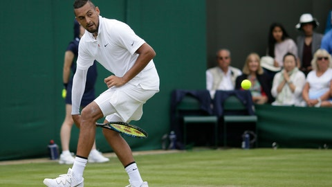 <p>               Australia's Nick Kyrgios returns the ball from between his legs to Australia's Jordan Thompson in a Men's singles match during day two of the Wimbledon Tennis Championships in London, Tuesday, July 2, 2019. (AP Photo/Tim Ireland)             </p>