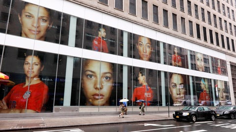 <p>               Portraits of the USA women's soccer team members are visible in the windows of a building on Fifth Avenue, in New York, Thursday, June 13, 2019. Women's soccer engages the U.S. every four years, then disappears for most fans like Brigadoon. In the wake of the Americans' record-setting fourth World Cup title Sunday, July 7, 2019, the hard part remains ahead: the weekly work of boosting the National Women's Soccer League. (AP Photo/Richard Drew)             </p>