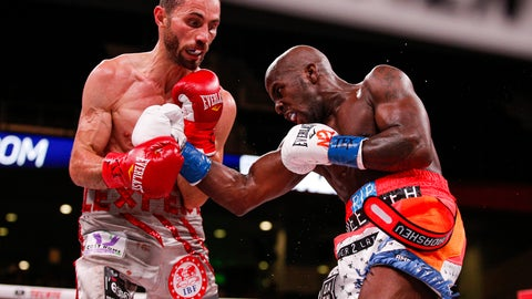 <p>               Tevin Farmer, right, lands a punch on Guillaume Frenois in the fifth round of a boxing match, Saturday, July 27, 2019, in Arlington, Texas. Farmer won the 12-round match. (AP Photo/Brandon Wade)             </p>