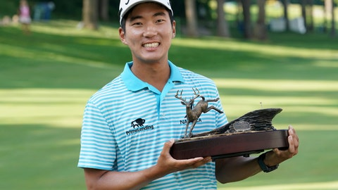 <p>               FILE - In this July 15, 2018, file photo, Michael Kim holds the trophy after winning the John Deere Classic golf tournament in Silvis, Ill. Kim had missed six out of seven cuts and changed coaches when he showed up at the John Deere Classic last year. He broke the tournament record at 27-under 257 and won by eight shots, matching Dustin Johnson and Francesco Molinari for the largest victory margin of the season. And then it was as if the week never happened. (AP Photo/Charlie Neibergall, File)             </p>