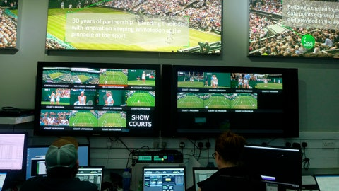 <p>               Staff monitor game data and work on match analysis at an operations room during the Wimbledon Tennis Championships in London, Wednesday, July 3, 2019. The All England Club is adding technology enhancements at this year's tournament aimed at eliminating bias from highlights that are chosen by computer artificial intelligence. (AP Photo/Kelvin Chan)             </p>