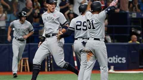 <p>               New York Yankees' Aaron Judge, left, celebrates with teammates after scoring during the 10th inning of a baseball game against the Tampa Bay Rays on Thursday, July 4, 2019, in St. Petersburg, Fla. (AP Photo/Scott Audette)             </p>