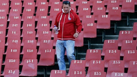 <p>               File-This June 24, 2015, file photo shows former rugby players James Small walking down the stairs during their 1995 Rugby World Cup-winning team reunion at Ellis Park stadium in Johannesburg, South Africa. Small was the rebel in the ultra-conservative world of South African rugby in the early 1990s. At a time when South Africans were breaking through the barriers of apartheid, people loved him for it. Even Nelson Mandela. Small died last week at the age of 50 of a suspected heart attack, leaving behind fragments of an often-reckless life that may provide a cautionary tale on how fragile sporting stardom is. But there are also glimmers of inspiration. (AP Photo/Themba Hadebe, File)             </p>