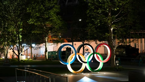 <p>               In this June 23, 2019, photo, a security officer uses a flashlight to check on the Olympic Rings in front of the New National Stadium in Tokyo. Overwhelmed by unprecedented demand, Tokyo Olympic organizers said Thursday they would run another ticket lottery next month for residents of Japan to view the games. Millions of Japanese were let down last month when they came away empty-handed without tickets for next year's Olympics. (AP Photo/Jae C. Hong)             </p>