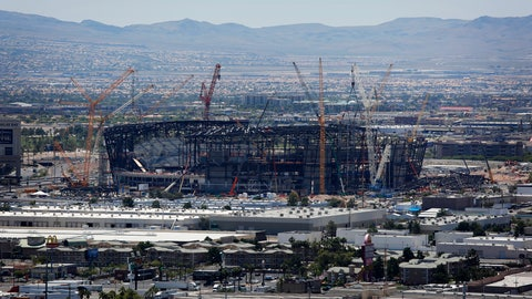 <p>               FILE - In this June 4, 2019, file photo, construction cranes surround the football stadium under construction in Las Vegas. Officials in Las Vegas have boosted the cost of a 65,000-seat stadium being built for the NFL's relocated Raiders and UNLV football to $1.9 billion. The Las Vegas Review-Journal reports the Las Vegas Stadium Authority board on Thursday, July 18, 2019, approved $40 million in additions. They include 20 more suites and a field-level club area to be paid for by personal seat license and club seat sales not part of the original budget. (AP Photo/John Locher, File)             </p>