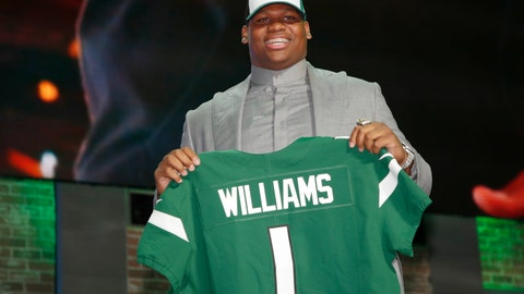 <p>               FILE - In this April 25, 2019, file photo, Quinnen Williams poses with his new team jersey after the New York Jets selected Williams in the first round at the NFL football draft in Nashville, Tenn. The New York Jets have reported for training camp without top draft pick Quinnen Williams, who remains unsigned. The sticking point appears to be the schedule of how Williams' signing bonus of about $21.7 million will be paid. The Jets hold their first camp practice Thursday morning, July 25. (AP Photo/Jeff Haynes, File)             </p>