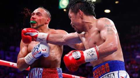 <p>               Manny Pacquiao, right, lands a punch against Keith Thurman in the fifth round during a welterweight title fight Saturday, July 20, 2019, in Las Vegas. (AP Photo/John Locher)             </p>