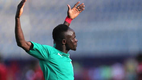 <p>               Senegal's Sadio Mane applauds fans prior to the start of the African Cup of Nations semifinal soccer match between Senegal and Tunisia in 30 June stadium in Cairo, Egypt, Sunday, July 14, 2019. (AP Photo/Hassan Ammar)             </p>