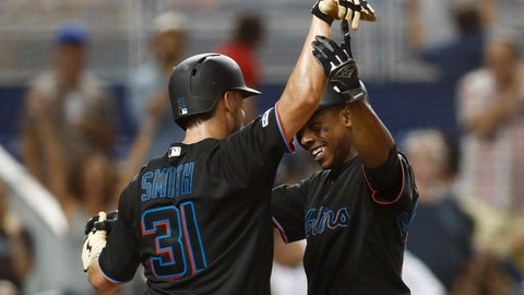 <p>               Miami Marlins' Curtis Granderson celebrates a two-run home run with Caleb Smith (31) during the third inning of the team's baseball game against the New York Mets on Friday, July 12, 2019, in Miami. (AP Photo/Brynn Anderson)             </p>